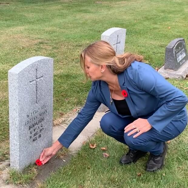 Maureen Bianchini Purvis lays a poppy at her late mother's headstone, a tradition that has turned into a campaign involving tens of thousands of students all across Canada.