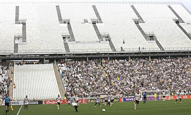 Corinthians's and Figueirense battle it out during a Brazilian soccer league match at the Itaquerao, the still unfinished stadium that will host the World Cup opener match between Brazil and Croatia on June 12, in Sao Paulo, Brazil, Sunday, May 18, 2014. Only 40,000 tickets were put on sale for Corinthians' match against Figueirense because some of the 20,000 temporary seats needed for the World Cup opener are still being installed. (AP Photo/Andre Penner)
