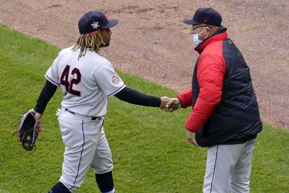 Cleveland Indians' Jose Ramirez, left, celebrates with manager Terry Francona after the Cleveland Indians defeated the Chicago White Sox 4-2 in a baseball game in Chicago, Thursday, April 15, 2021. (AP Photo/Nam Y. Huh)