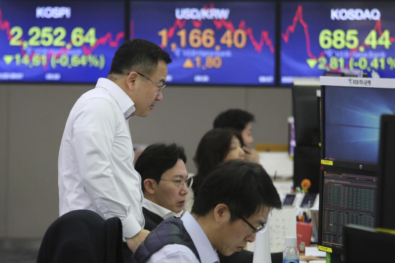 Currency traders watch monitors at the foreign exchange dealing room of the KEB Hana Bank headquarters in Seoul, South Korea, Thursday, Jan. 23, 2020. Asian shares are mostly higher as health authorities around the world move to monitor and contain a deadly virus outbreak in China and keep it from spreading globally. (AP Photo/Ahn Young-joon)