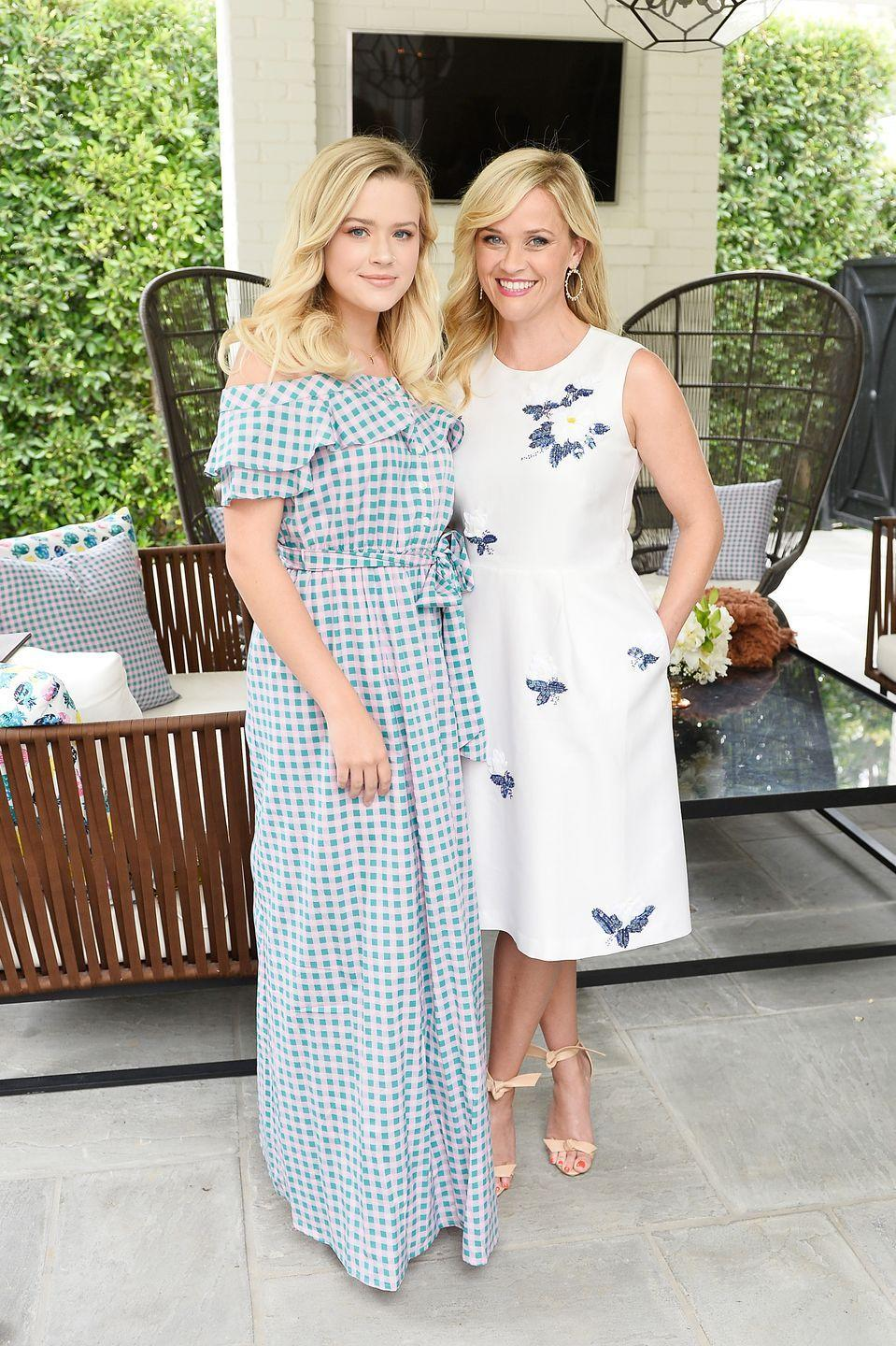 <p>The blonde beauties matched in blue and white dresses at the NET-A-PORTER x Draper James Event</p>