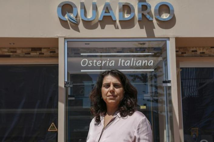 Cypriot restauranteur Elena Isaac fears her four eateries will not generate enough revenue to cover rent and salaries this year (AFP Photo/Christina ASSI)
