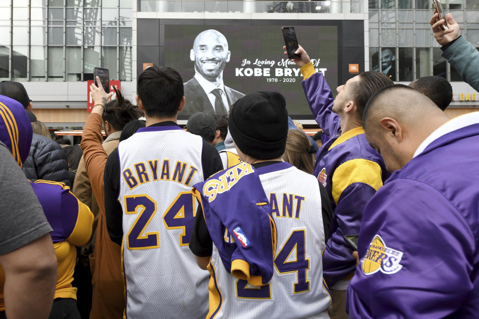 People gather outside Staples Center after the death of Laker legend Kobe Bryant Sunday, Jan. 26, 2020, in Los Angeles. (AP Photo/Michael Owen Baker)