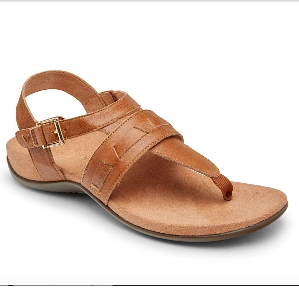 """<p><strong>Vionic</strong></p><p>vionicshoes.com</p><p><strong>$109.95</strong></p><p><a href=""""https://go.redirectingat.com?id=74968X1596630&url=https%3A%2F%2Fwww.vionicshoes.com%2Flupe-sandal.html%3F76%3D853&sref=https%3A%2F%2Fwww.goodhousekeeping.com%2Fclothing%2Fg33264582%2Fmost-comfortable-shoes%2F"""" rel=""""nofollow noopener"""" target=""""_blank"""" data-ylk=""""slk:Shop Now"""" class=""""link rapid-noclick-resp"""">Shop Now</a></p><p>Available in both medium and wide sizing, these <a href=""""https://www.goodhousekeeping.com/clothing/g26357823/best-walking-sandals/"""" rel=""""nofollow noopener"""" target=""""_blank"""" data-ylk=""""slk:walking sandals"""" class=""""link rapid-noclick-resp"""">walking sandals</a> from Vionic also have an adjustable back strap to ensure a proper fit. The <strong>footbed is covered in a smooth microfiber material </strong>for a soft feel with each step. Plus, the footbed is designed to absorb shock for easy all day walking. Some reviewers recommend going down half a size for extra comfortable shoes. </p>"""