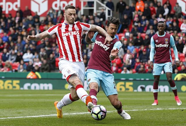 <p>Stoke City's Marko Arnautovic in action with West Ham United's Jose Fonte </p>