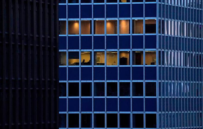 Employees work in an office building in Midtown, New York City, on Jan. 26.