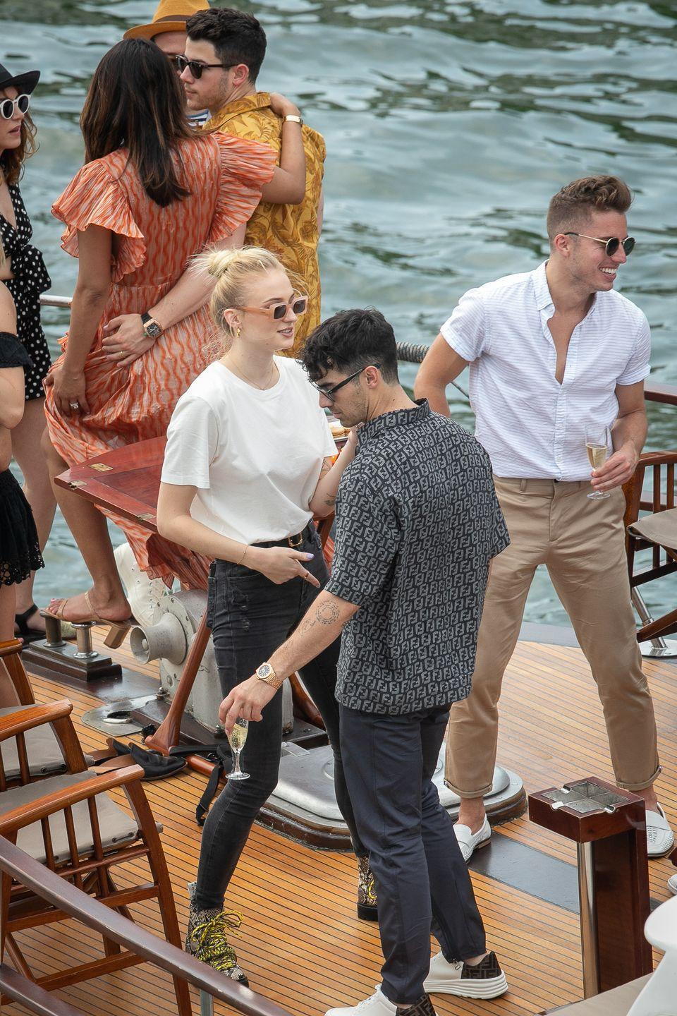"""<p>Dancing on board a yacht together for their<a href=""""https://www.elle.com/uk/life-and-culture/wedding/a28182548/sophie-turner-joe-jonas-wedding-dress-pictures/"""" rel=""""nofollow noopener"""" target=""""_blank"""" data-ylk=""""slk:pre-wedding festivities in Paris."""" class=""""link rapid-noclick-resp""""> pre-wedding festivities in Paris.</a></p>"""