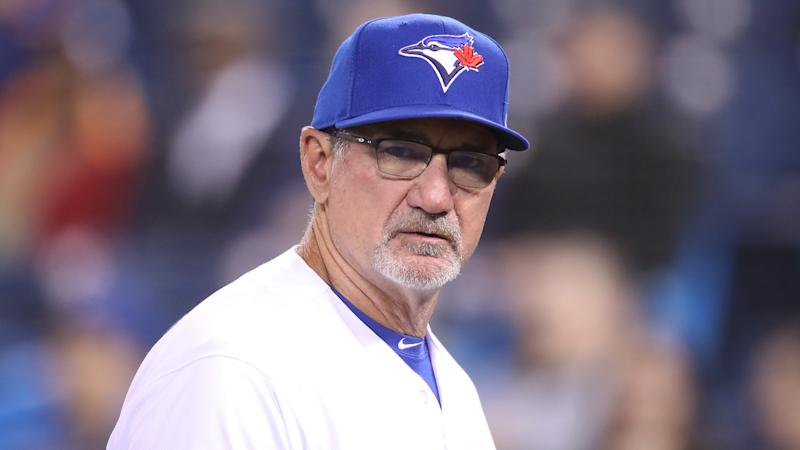 TORONTO, ON - APRIL 02: Bench coach Dave Hudgens #39 of the Toronto Blue Jays walks back to the dugout after delivering the lineup card at home plate before the start of MLB game action against the Baltimore Orioles at Rogers Centre on April 2, 2019 in Toronto, Canada. (Photo by Tom Szczerbowski/Getty Images)