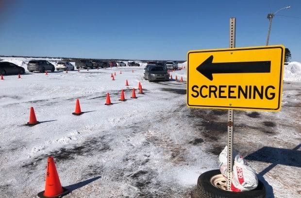 Cars line up in February at the drive-thru testing clinic at Summerside's Slemon Park. The clinic has delayed opening Saturday due to poor weather. (Brittany Spencer/CBC - image credit)