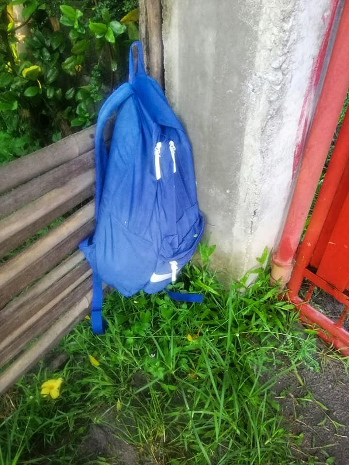The blue backpack hanging on the fence with the baby inside. Source: Viral Press