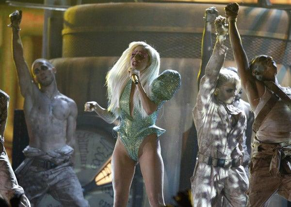 Lady Gaga takes to the stage in a typically revealing number