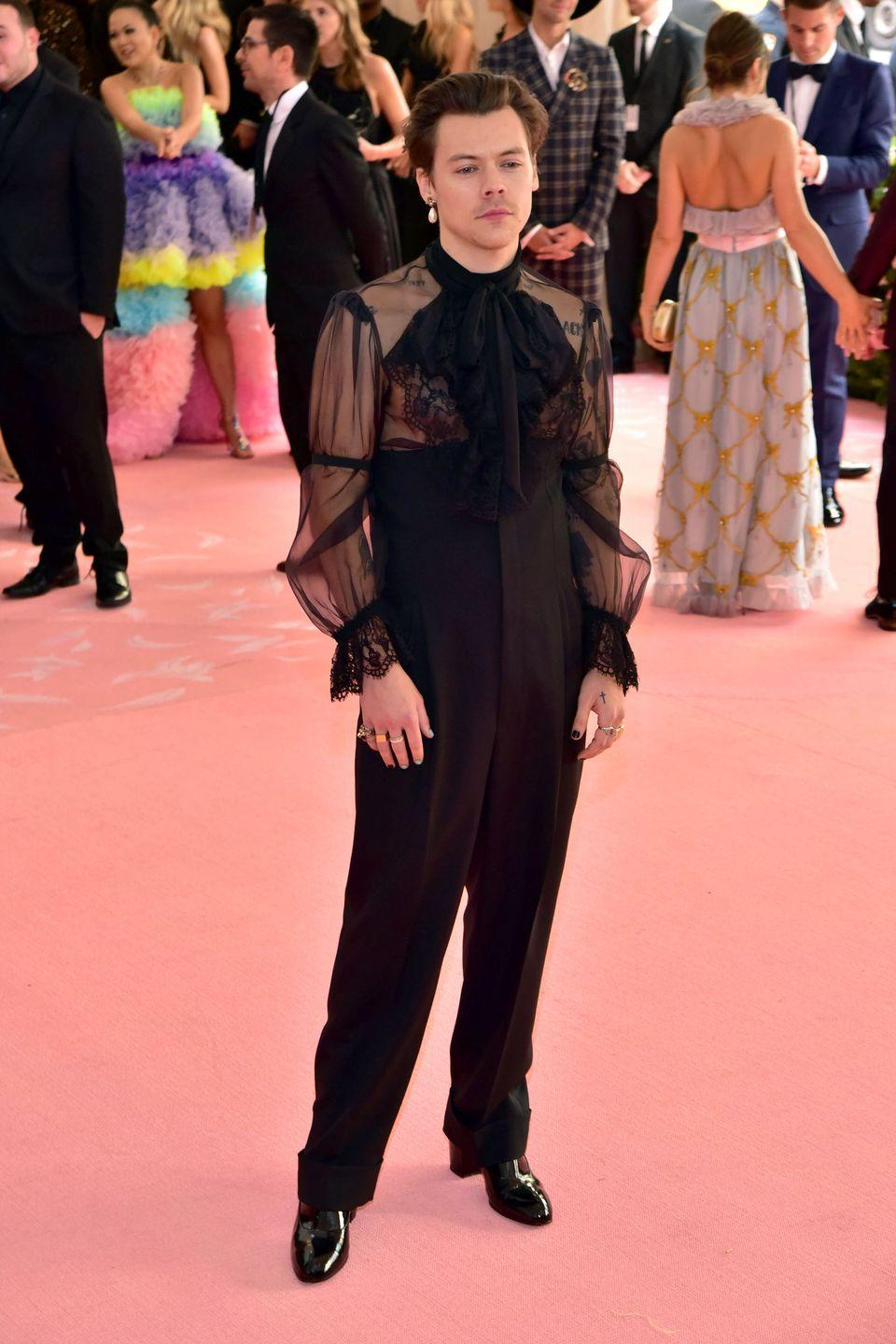 """<p>The 2019 Met Gala was all about camp: a dress code inspired by Susan Sontag's seminal essay on """"the psychopathology of affluence"""". Many guests hit the mark. Styles did not thanks to a little help from Gucci. </p>"""