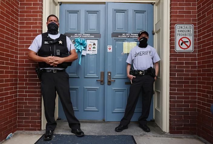 Deputies stand in front of the entrance to the Pasquotank County Courthouse in Elizabeth City, N.C., on Wednesday. (Joe Raedle/Getty Images)
