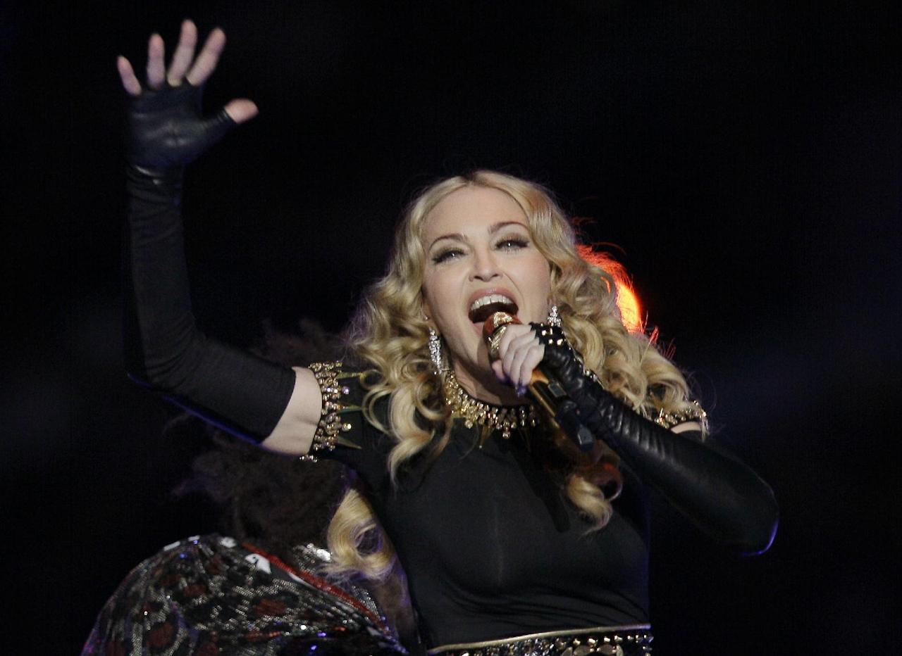 Madonna performs during halftime of the NFL Super Bowl XLVI football game between the New York Giants and the New England Patriots, Sunday, Feb. 5, 2012, in Indianapolis. (AP Photo/Mark Humphrey)