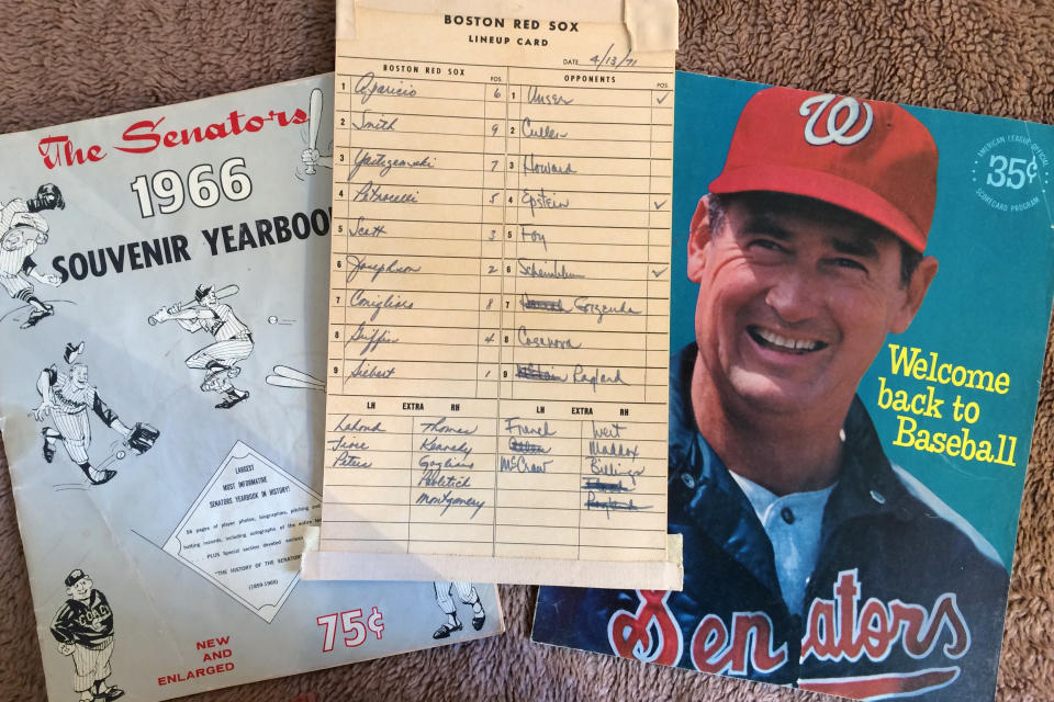 Washington Senators memorabilia including the lineup card from a game between the Senators and Boston Red Sox on April 13, 1971, in Washington, and a program featuring Ted Williams, right, are shown in New York, Tuesday, Oct. 15, 2019. (AP Photo/Ben Walker)