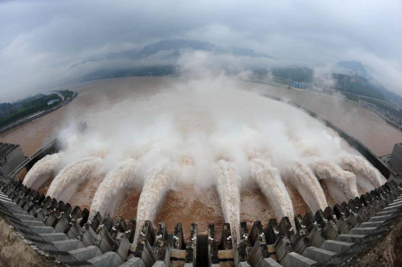 FILE - In this July 20, 2010 photo released by China's Xinhua news agency, flood water is released from the Three Gorges Dam's floodgates in Yichang, in central China's Hubei province.  Another 100,000 people may have to move away from China's Three Gorges Dam due to the risk of disastrous landslides and bank collapses around the reservoir of the world's biggest hydroelectric facility, a state media said Wednesday, April 18, 2012.  (AP Photo/Xinhua, Cheng Min, File) NO SALES