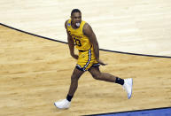 <p>UMBC's Arkel Lamar reacts after making a basket against Virginia during the second half of a first-round game in the NCAA men's college basketball tournament in Charlotte, N.C., Friday, March 16, 2018. (AP Photo/Chuck Burton) </p>