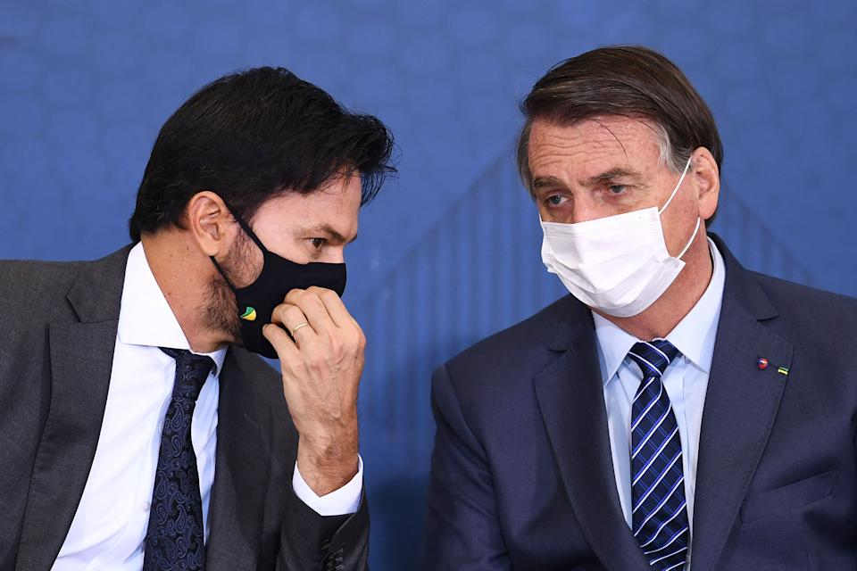 Brazilian President Jair Bolsonaro (R) and his Communication Minister Fabio Faria attend the launching event of the Week of Communication at the Planalto Palace in Brasilia, on May 5, 2021. - Bolsonaro called those who are against early treatment with Chloroquine against COVID-19 a 'scoundrel'. (Photo by EVARISTO SA / AFP) (Photo by EVARISTO SA/AFP via Getty Images)