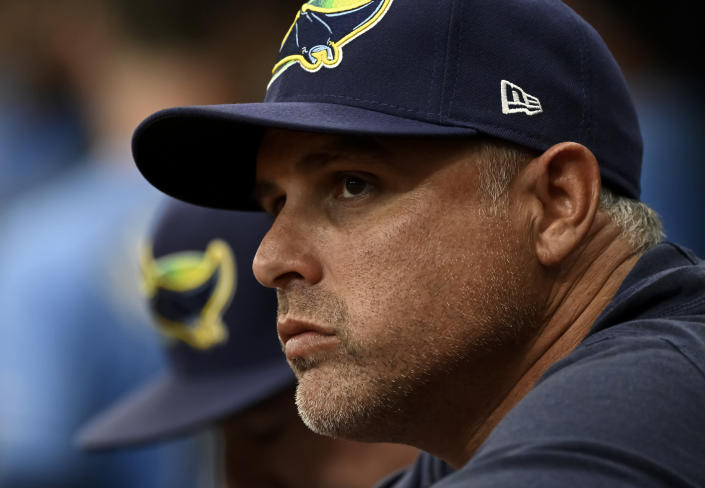 Tampa Bay Rays manager Kevin Cash watches from the dugout during the fourth inning of a baseball game against the Miami Marlins, Sunday, Sept. 26, 2021, in St. Petersburg, Fla. (AP Photo/Steve Nesius)