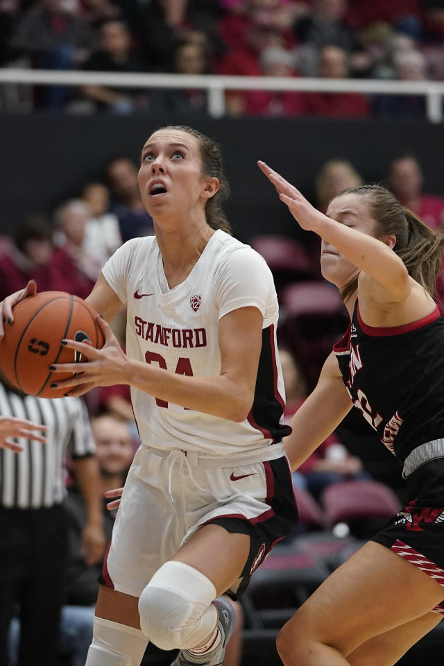 Stanford guard Lacie Hull (24) drives to the basket against Eastern Washington guard Brittany Klaman (22) during the first half of an NCAA college basketball game Tuesday, Nov. 5, 2019, in Stanford, Calif. (AP Photo/Tony Avelar)