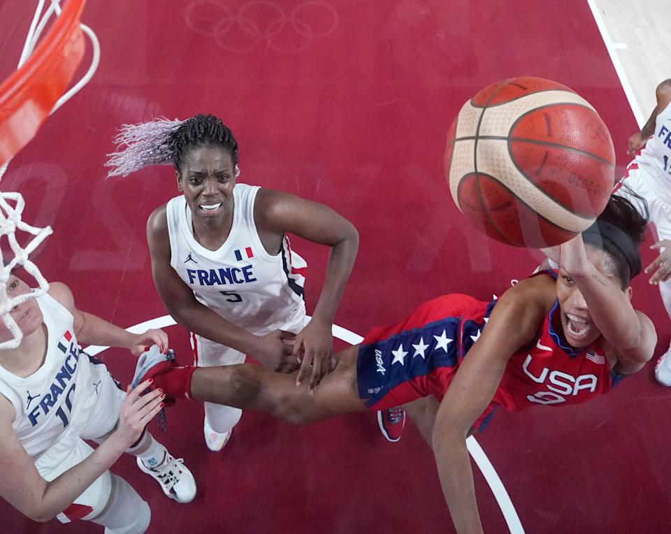 A'ja Wilson shoots while being defended by France player Sarah Michel.