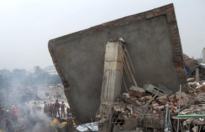 Rescue and recovery personnel prepare to dislodge the ceiling of the garment factory building which collapsed on Wednesday, in Savar, near Dhaka, Bangladesh, Monday April 29, 2013. Rescue workers in Bangladesh gave up hopes of finding any more survivors in the remains of a building that collapsed five days ago, and began using heavy machinery on Monday to dislodge the rubble and look for bodies - mostly of workers in garment factories there. At least 381 people were killed when the illegally constructed, 8-story Rana Plaza collapsed in a heap on Wednesday morning along with thousands of workers in the five garment factories in the building.(AP Photo/Wong Maye-E)