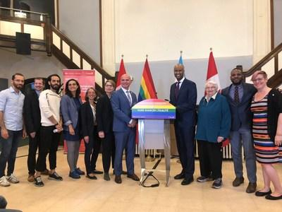 Minister Ahmed Hussen and MP Randy Boissonnault with members of the Rainbow Coalition for Refuge at the Metropolitan Community Church of Toronto for Saturday's announcement of the expansion of the Rainbow Refugee Assistance Program (RRAP), a program which helps support refugees fleeing persecution because of their sexuality orientation or gender identity or expression (SOGIE). (CNW Group/Rainbow Railroad)