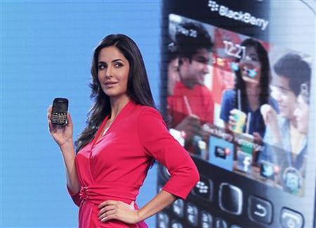 Bollywood actress Katrina Kaif poses with the newly launched BlackBerry Curve 9220 smartphone in New Delhi