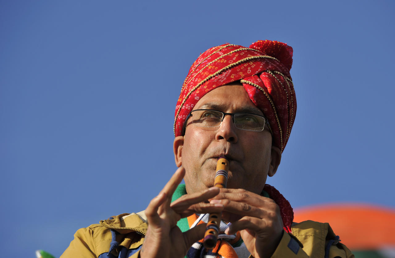 An Indian fan plays the flute during the 2013 ICC Champions Trophy cricket match between Pakistan and India at Edgbaston in Birmingham, central England on June 15, 2013.  (GLYN KIRK/AFP/Getty Images)