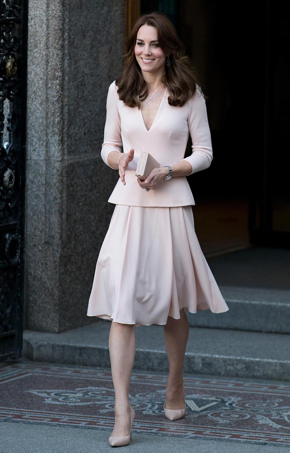 <p>Kate's trip to a Vogue exhibition at the National Portrait Gallery saw the Duchess in a sweet pink peplum dress by one of her favourite labels, Alexander McQueen. As usual, an L.K. Bennett clutch and shoes completed her ensemble.</p><p><i>[Photo: PA]</i></p>