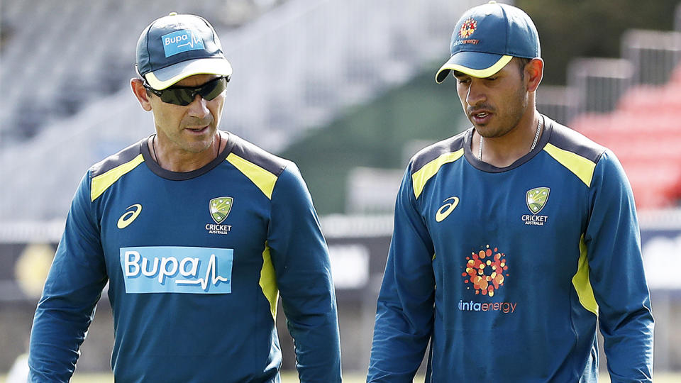 Australian cricket coach Justin Langer is pictured in conversation with Usman Khawaja.