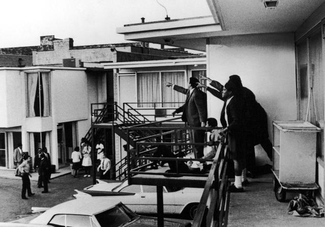 Civil rights leader Andrew Young, left, and others on the balcony of the Lorraine Motel point in the direction of shots after the assassination of King, who is lying at their feet. (Photo: Joseph Louw/The Life Images Collection/Getty Images)