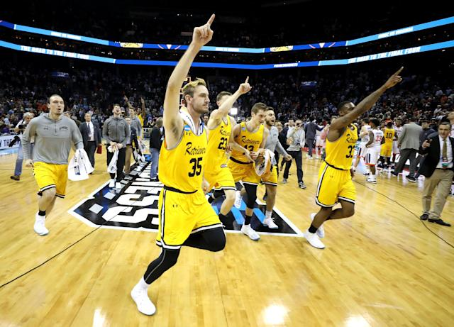 The UMBC Retrievers celebrate their 74-54 victory over the Virginia Cavaliers during the first round of the 2018 NCAA Men's Basketball Tournament at Spectrum Center on March 16, 2018 in Charlotte, NC. UMBC became the first No. 16 seed to beat a No. 1 seed in tournament history. (Photo by Streeter Lecka/Getty Images)