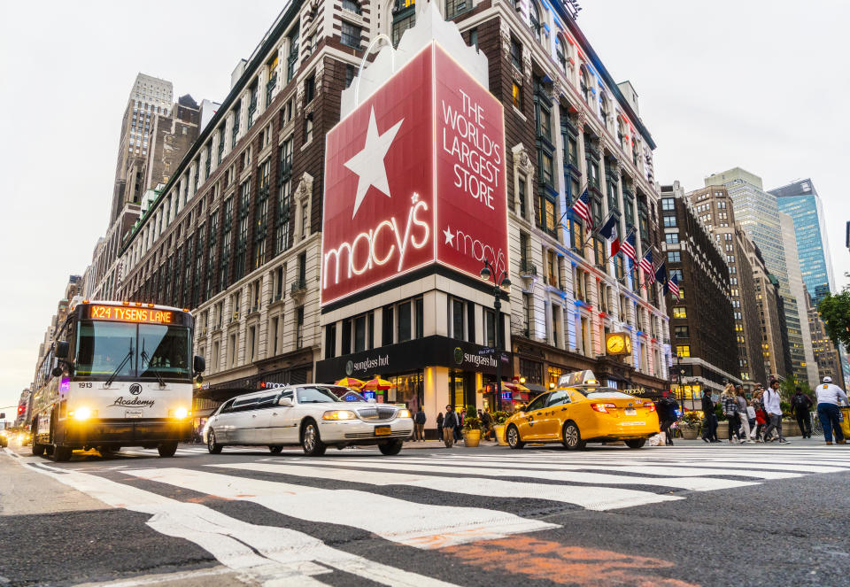 New York City, USA - May 19, 2016: Macy's Herald Square Store which is the flagship store for Macy's located on Herald Square in Manhattan, New York City. People and cars moving alongside the street. Image taken with a wide angle lens