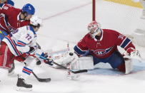 New York Rangers' Filip Chytil (72) moves in on Montreal Canadiens goaltender Carey Price as Canadiens' Ben Chiarot defends during the third period of an NHL hockey game Saturday, Nov. 23, 2019, in Montreal. (Graham Hughes/The Canadian Press via AP)