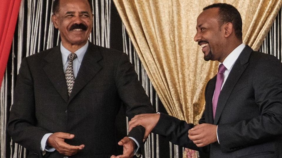 Eritrea's President Isaias Afwerki and Ethiopia's Prime Minister Abiy Ahmed smiling