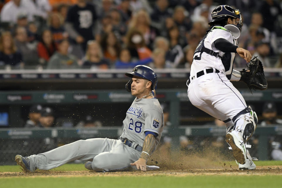 Kansas City Royals' Kyle Isbel (28) slides home safely past Detroit Tigers catcher Eric Haase on a sacrifice fly from Whit Merrifield in the eighth inning of a baseball game, Friday, Sept. 24, 2021, in Detroit. (AP Photo/Jose Juarez)