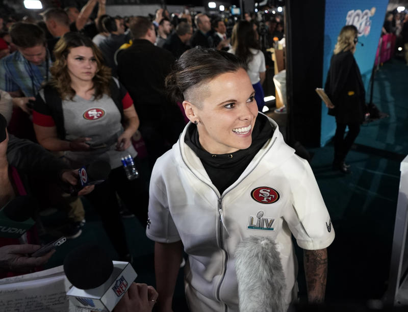 San Francisco 49ers assistant coach Katie Sowers speaks to reporters during Opening Night for Super Bowl LIV. (AP Photo/David J. Phillip)