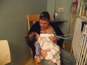 Tabitha caring for her child at hospital