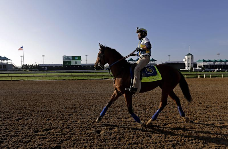 Trainer Rudy Rodriguez rides Kentucky Derby entrant Vyjack for a workout at Churchill Downs Tuesday, April 30, 2013, in Louisville, Ky. (AP Photo/Morry Gash)