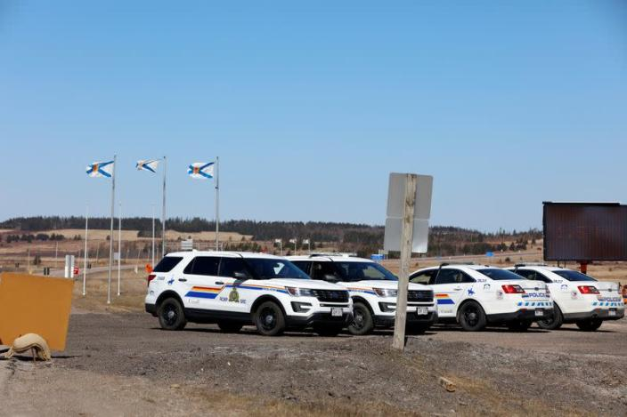 RCMP officers maintain a road block while searching for Gabriel Wortman in Portapique