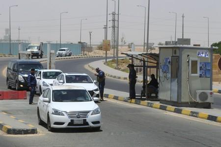 Iraqi security officers stay guard at the entry of Zubair oilfield after a rocket struck the site of residential and operations headquarters of several oil companies at Burjesia area in Basra