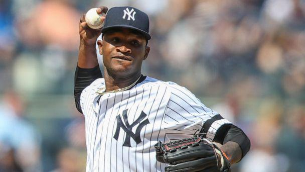 PHOTO: This is an Aug. 31, 2019, file photo showing New York Yankees pitcher Domingo German throwing to first in a pickoff attempt during the fifth inning of a baseball game against the Oakland Athletics, in New York. (Mary Altaffer/AP, File)
