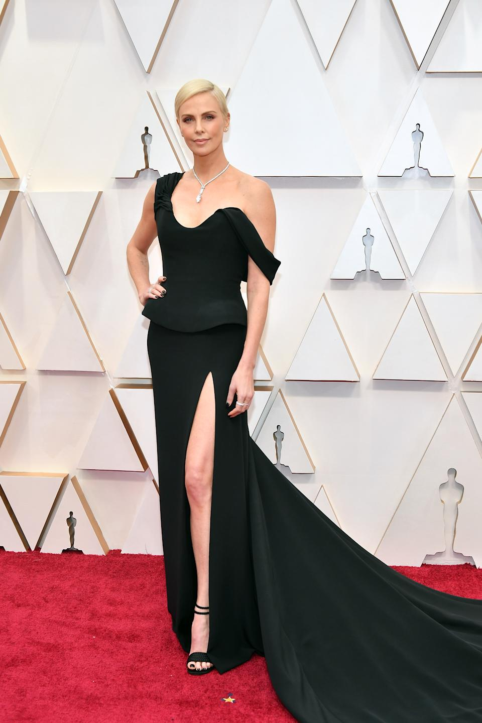"""The Oscar winner and Best Actress nominee for her portrayal of Megyn Kelly in """"Bombshell"""" looked elegant in a black gown by Dior."""