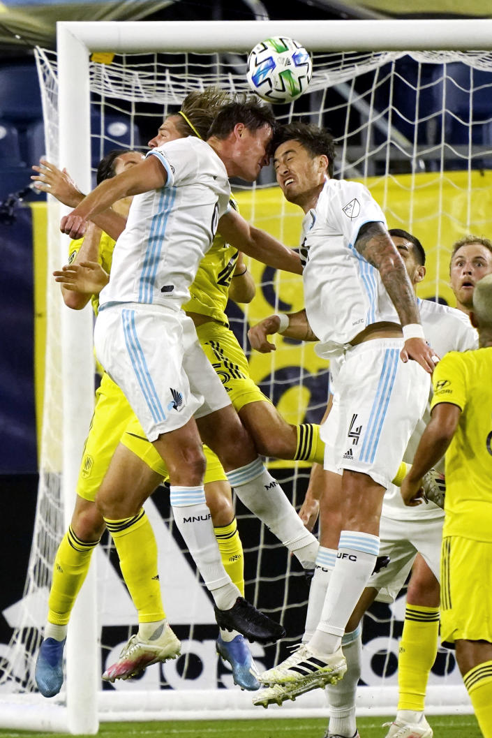 Minnesota United forward Aaron Schoenfeld, left, and defender Jose Aja (4) head the ball in front of the Nashville SC goal during the first half of an MLS soccer match Tuesday, Oct. 6, 2020, in Nashville, Tenn. (AP Photo/Mark Humphrey)