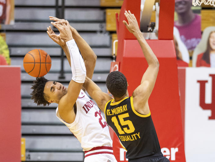 Indiana forward Trayce Jackson-Davis (23) and Iowa forward Keegan Murray (15) battle for a rebound during the second half of an NCAA college basketball game, Sunday, Feb. 7, 2021, in Bloomington, Ind. (AP Photo/Doug McSchooler)