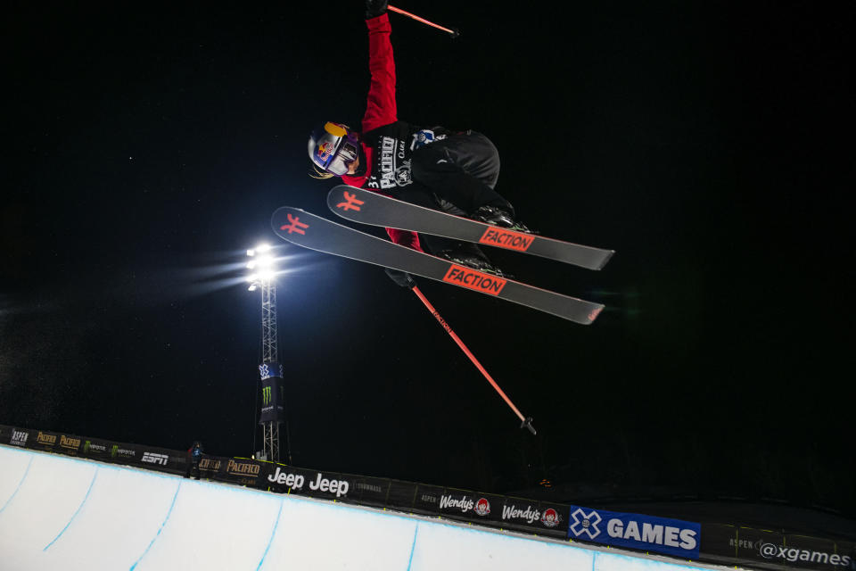 CORRECTS TO THE ASPEN TIMES, NOT THE ASPEN DAILY NEWS - Winter X Games rookie Eileen Gu airs out of the superpipe during women's finals at the 2021 Winter X Games Aspen on Friday, Jan. 29, 2021, in Aspen, Colo. Gu took home the gold in her first superpipe final. (Kelsey Brunner/The Aspen Times via AP)