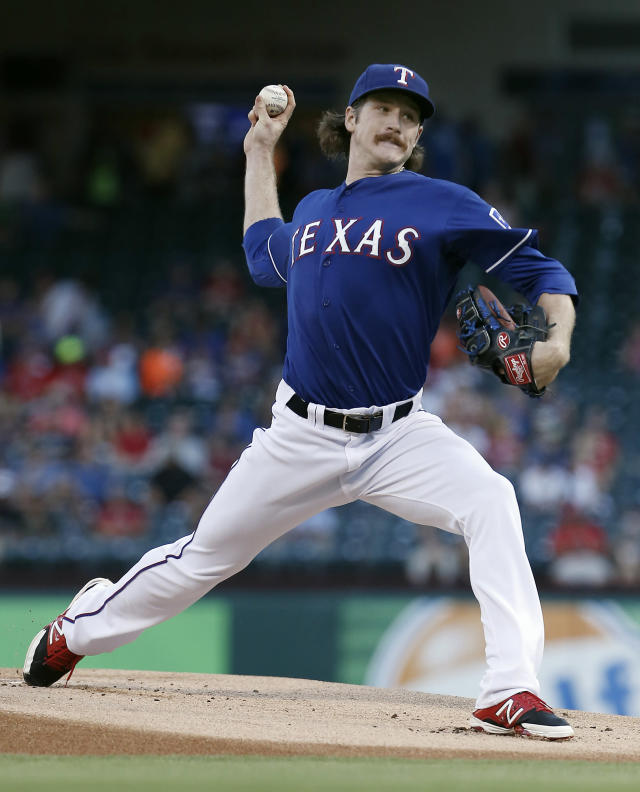 Texas Rangers starting pitcher Miles Mikolas (36) throws during the first inning of a baseball game against the Tampa Bay Rays, Wednesday, Aug. 13, 2014, in Arlington, Texas. (AP Photo/Brandon Wade)