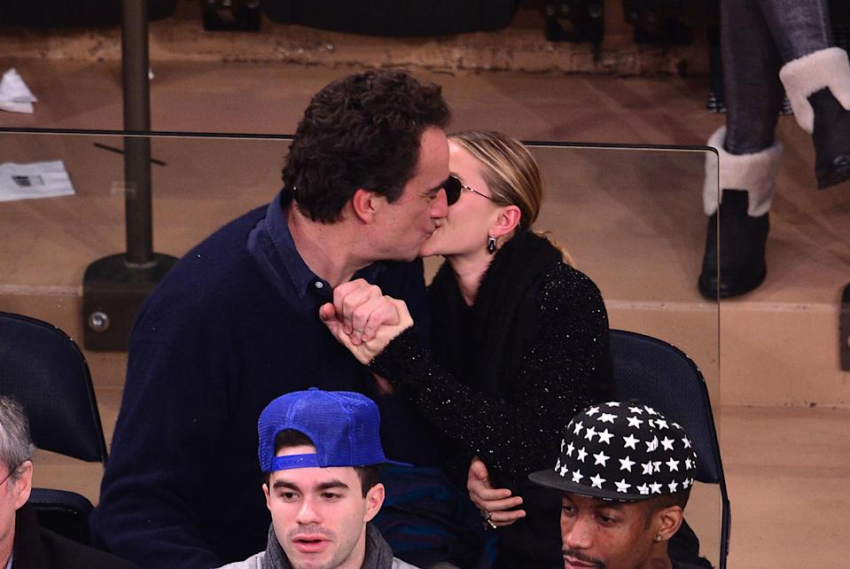 Olivier Sarkozy and Mary-Kate Olsen attend the Atlanta Hawks vs New York Knicks game at Madison Square Garden on December 14, 2013 in New York City. (Photo: FilmMagic)