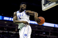 <p>Zion Williamson #1 of the Duke Blue Devils saves the ball from going out of bounds against the North Dakota State Bison in the first half during the first round of the 2019 NCAA Men's Basketball Tournament at Colonial Life Arena on March 22, 2019 in Columbia, South Carolina. </p>